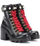 Gucci - Ankle Boots Trip aus Leder - 980.00 €