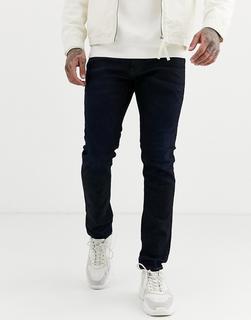 G-Star - D-Staq – Schmale Jeans mit 5 Taschen in dunkler Aged-Waschung-Blau