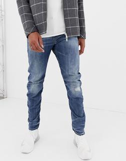 G-Star - Arc 3d - Schmal geschnittene Super-Stretch-Jeans in mittlerer Waschung mit Distressed-Detail - Blau