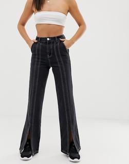 ASOS DESIGN - Ausgestellte schwarze Schlag-Jeans mit weißen Steppnähten und Schlitz vorn, volle Länge - Schwarz