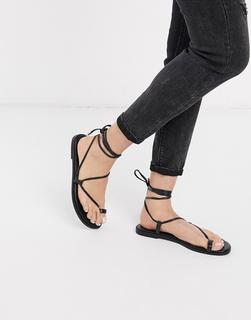 ASOS DESIGN - Forest – Minimalistische Sandalen mit Zehenschlaufe in Schwarz