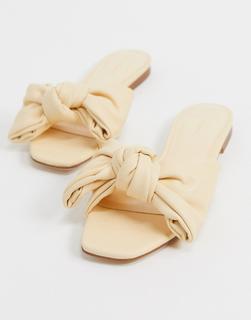 MANGO - Flache Sandalen mit Schleife in Sanftgelb