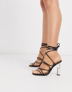 Truffle Collection - Schwarze Sandalen mit Knöchelschnürung und hohem, transparentem Absatz