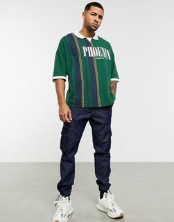 ASOS DESIGN - Polohemd aus Bio-Baumwollpikee mit Farbblockdesign und sportlichem Ausschnitt-Grün