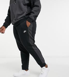 Nike - Plus Club – Schwarze Jogginghose mit Bündchen und Farbblockdesign
