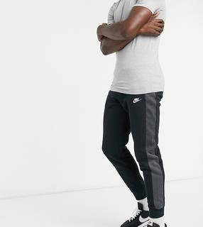 Nike - Tall – Club – Jogginghose mit Bündchen und Farbblockdesign in Schwarz