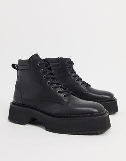 ASOS DESIGN - Schnürstiefel aus schwarzem, glänzendem Leder mit dicker Sohle
