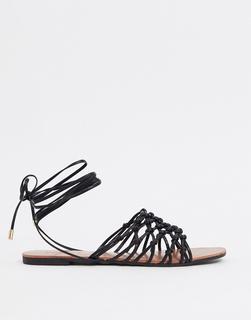 Truffle Collection - Flache Sandalen in Schwarz mit Beinschnürung