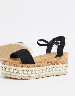 Truffle Collection - Schwarze Flatform-Sandalen mit Nietenbesatz