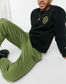 Crooked Tongues - Jogginghose mit Logoprint in Khaki-Grün