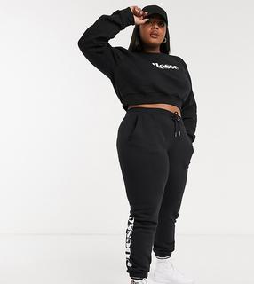Ellesse - Plus – Set mit kurz geschnittenem Pullover und Jogginghose in Schwarz
