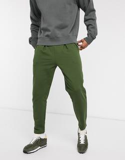 ASOS DESIGN - Plissierte Jersey-Jogginghose aus Bio-Baumwolle in Grün
