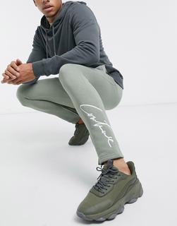 The Couture Club - Essentials – Schmal geschnittene Jogginghose in Khaki-Grün