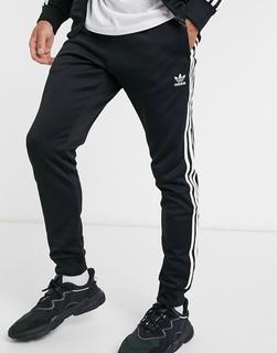 adidas Originals - Adicolour – Enge Jogginghose mit 3 Streifen in Schwarz