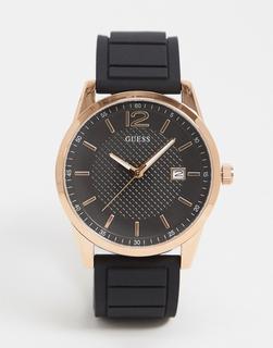 guess - Schwarze Armbanduhr mit goldfarbenen Details