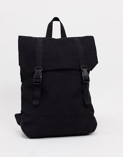 ASOS DESIGN - Rucksack aus Cord in Schwarz mit Kunstlederboden