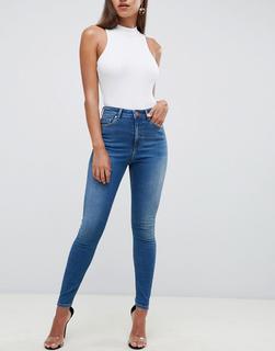 ASOS DESIGN - Ridley – Enge Jeans mit hoher Taille und unregelmäßig blauer Stone-Waschung