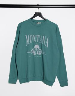 ASOS DESIGN - Sweatshirt mit Vintage-Montana-Print in verwaschenem Grün