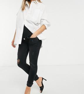 River Island Maternity - Amelie – Enge Jeans mit Überbauchbund, Zierrissen und Umschlägen in verwaschenem Schwarz-Blau