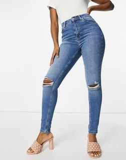 NA-KD - Enge Jeans in Mittelblau aus Bio-Baumwolle mit hohem Bund und Rissen