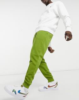 ASOS DESIGN - Schmal zulaufende Jogginghose mit Biesen in Khaki-Grün