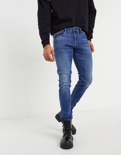 G-Star - 3301 – Enge Deconstructed-Jeans in mittlerer Indigo Aged-Waschung-Blau