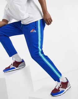 Tommy Jeans - Jogginghose in Blau mit Berg-Logo und seitlichen Streifen