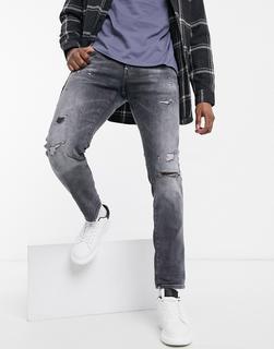 G-Star - Eng geschnittene Distressed-Jeans in Schwarz