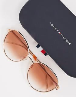 TOMMY HILFIGER - Runde Sonnenbrille mit goldfarbenem Metallgestell und braunen Gläsern